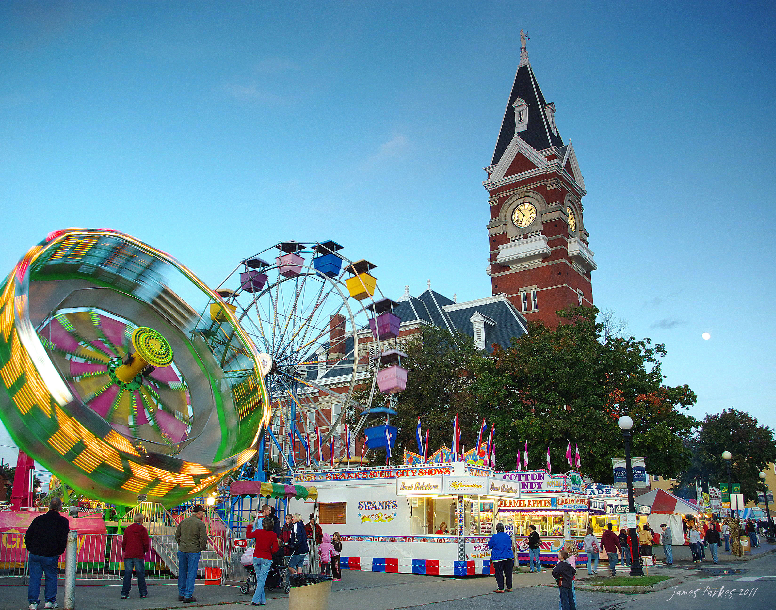 Clarion County Courthouse and Festival carnival at dusk