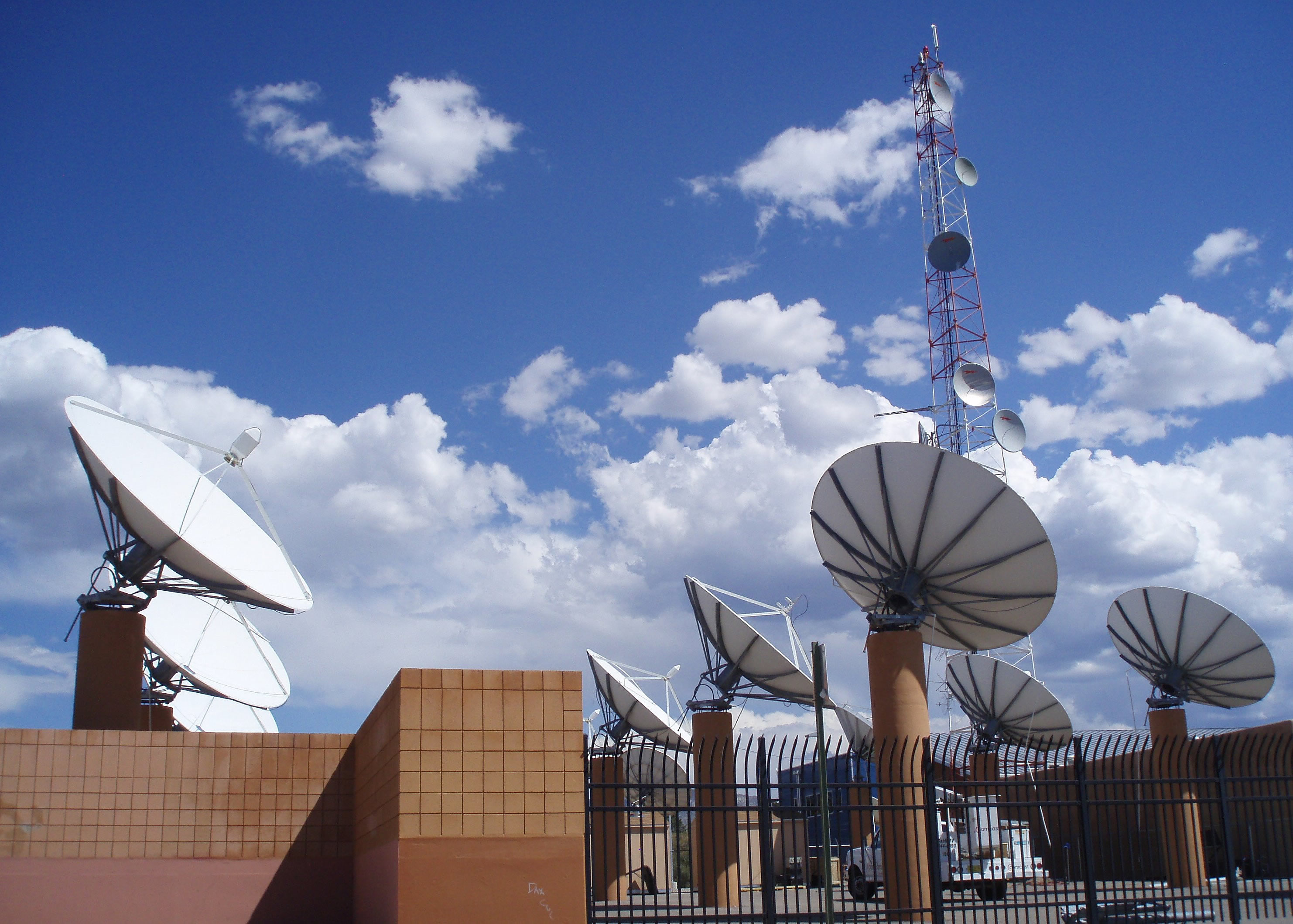 Cable facility with satellite dishes