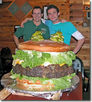 Denny Liegey poses with 100 pound burger