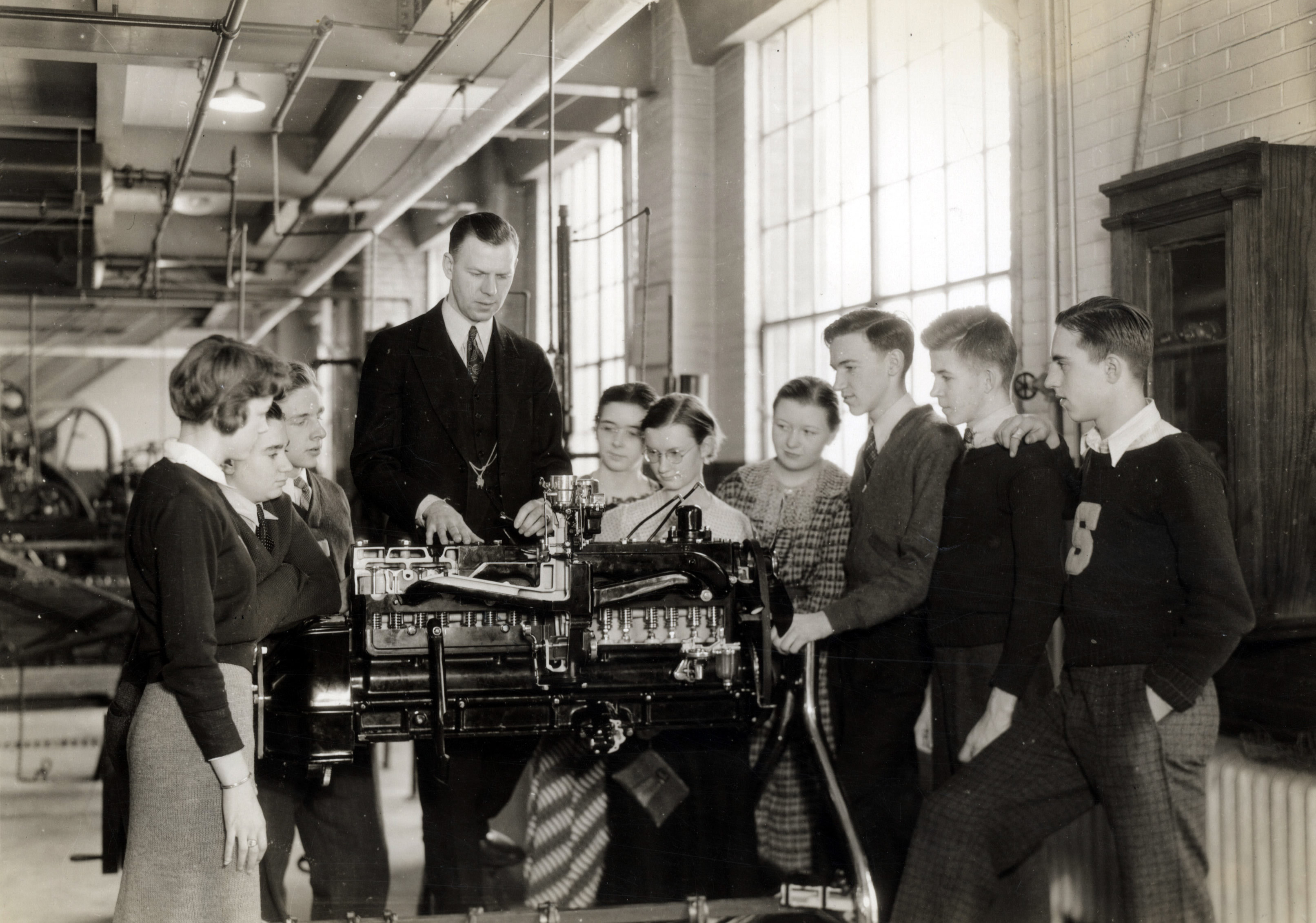 Students learning about the workings of an automobile engine