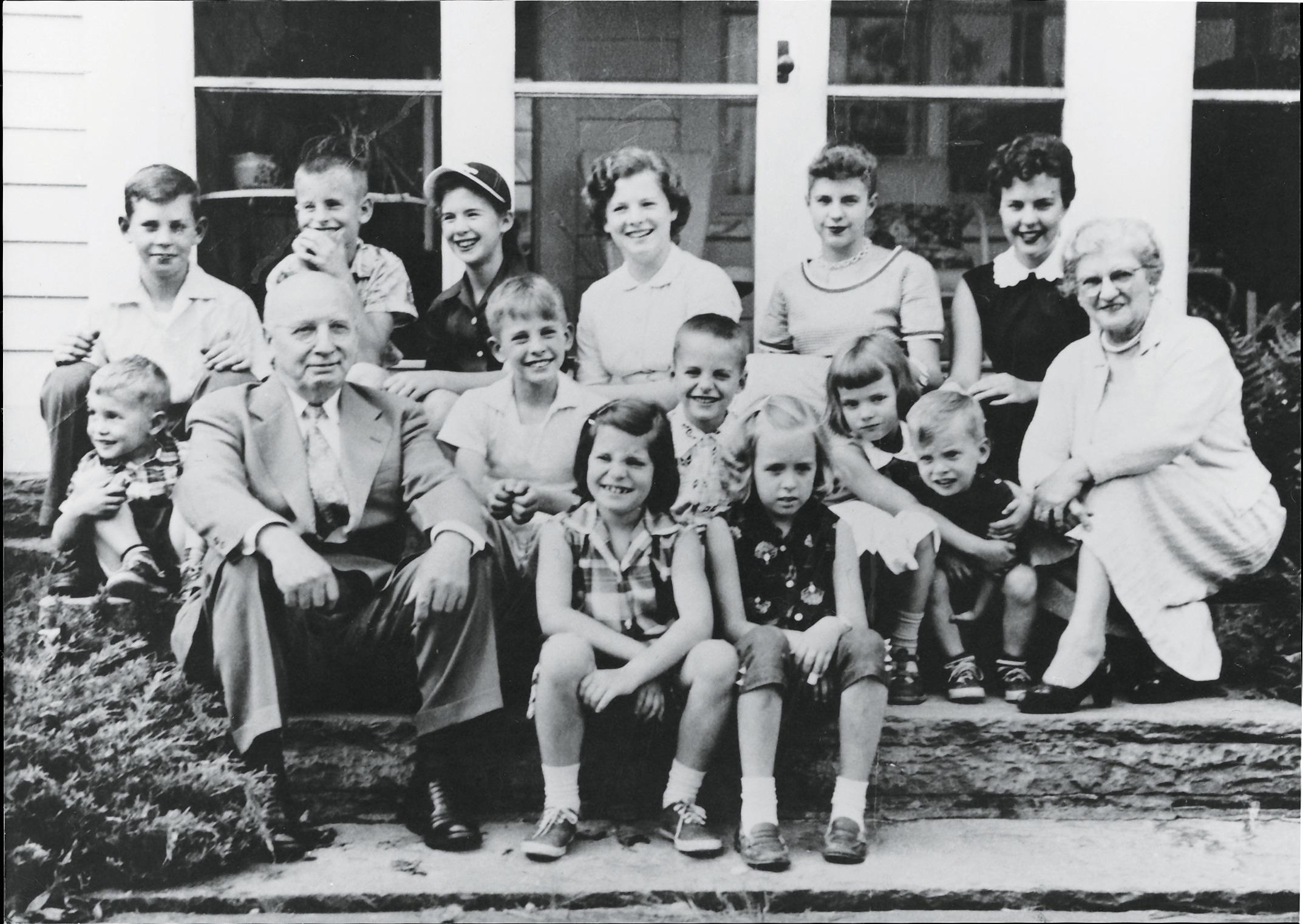 Garry and Caroline Myers with their 13 grandchildren