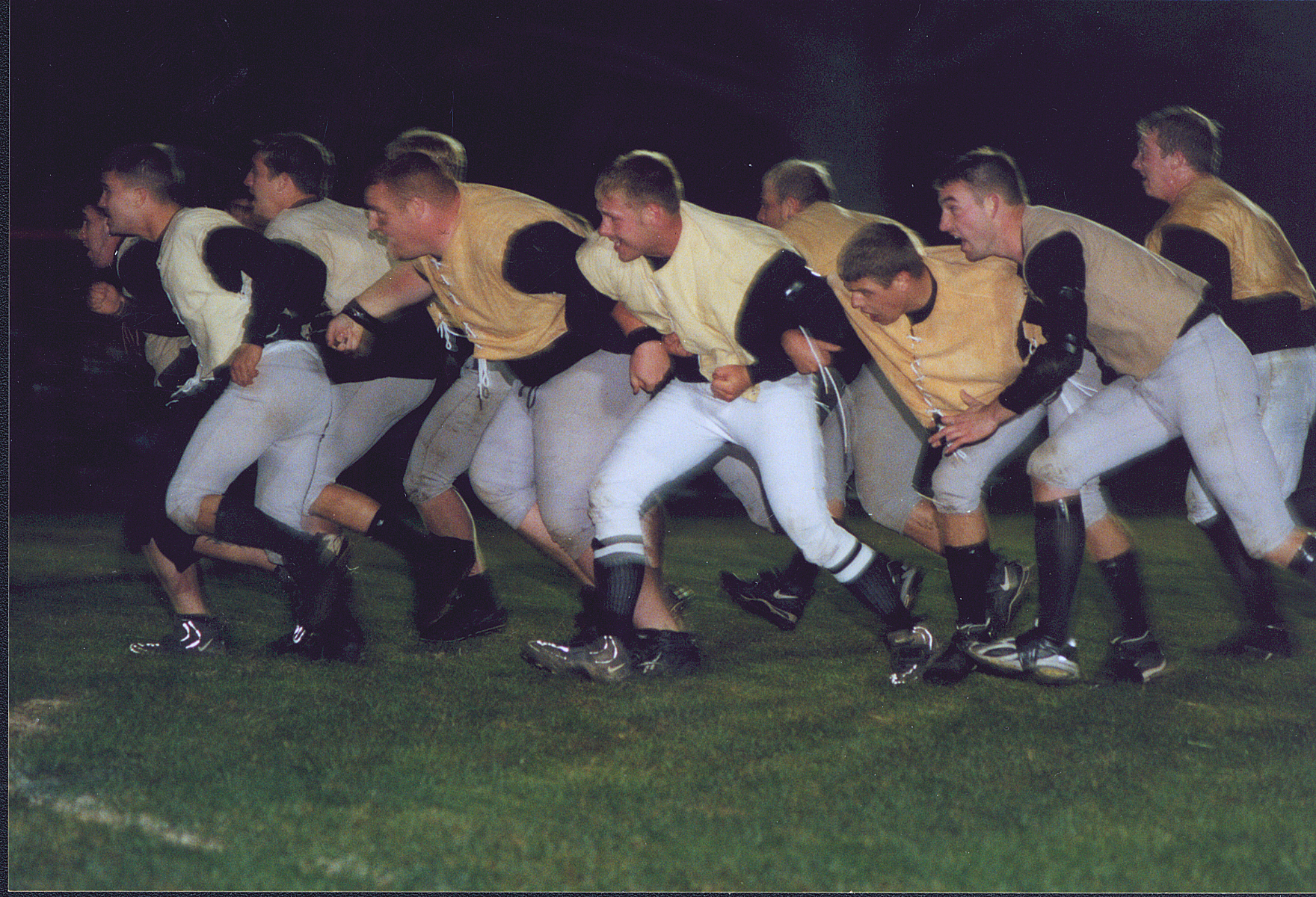 Football players in the wedge formation